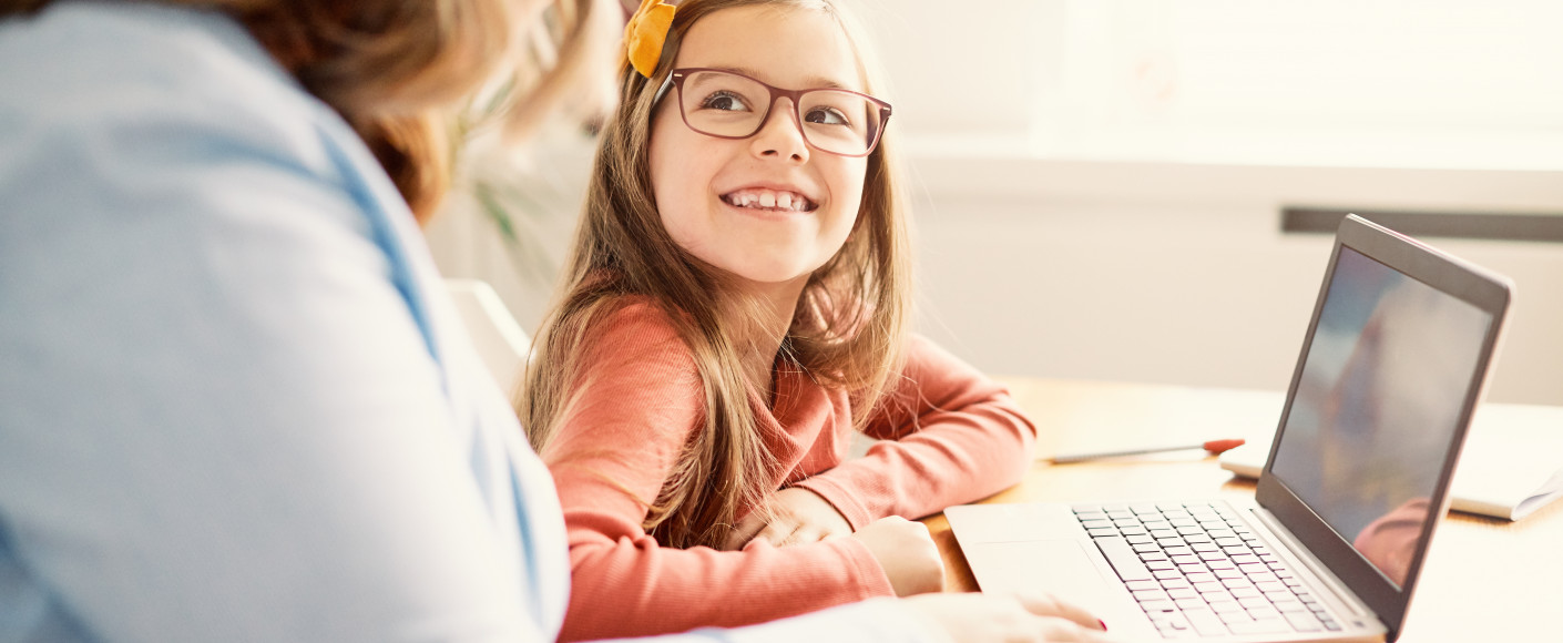 Child at computer for virtual farm tours