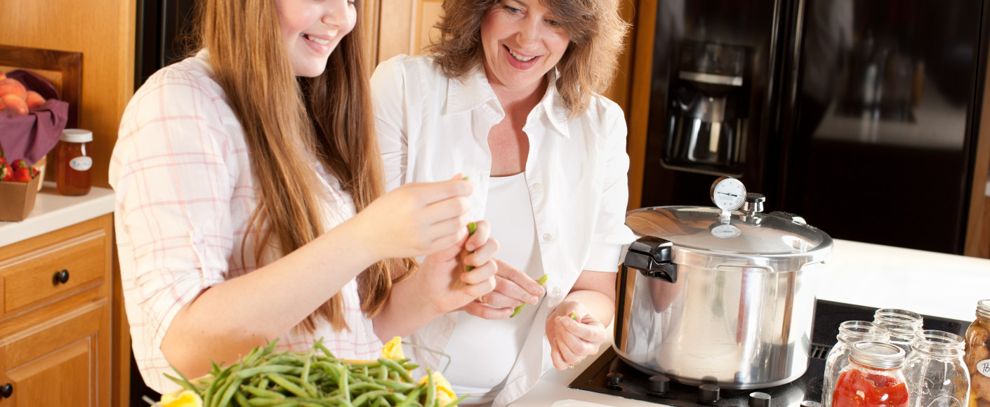 Mother and Daughter with Pressure Cooker