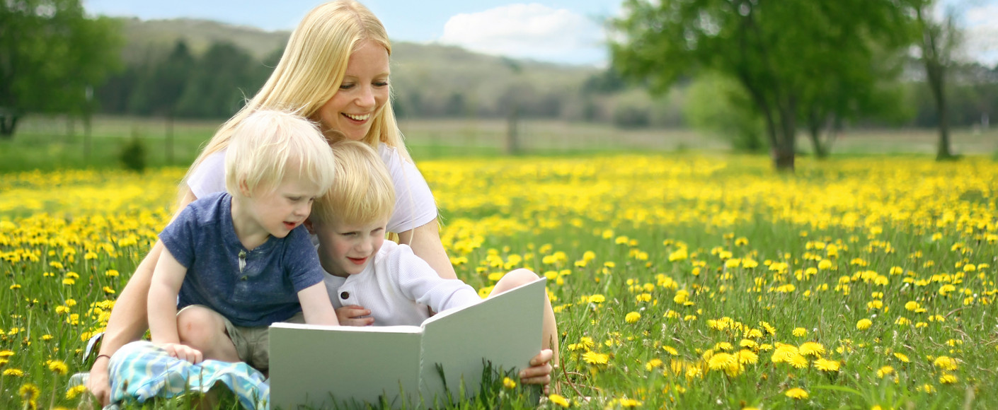 Mother Reading to Children on Farm