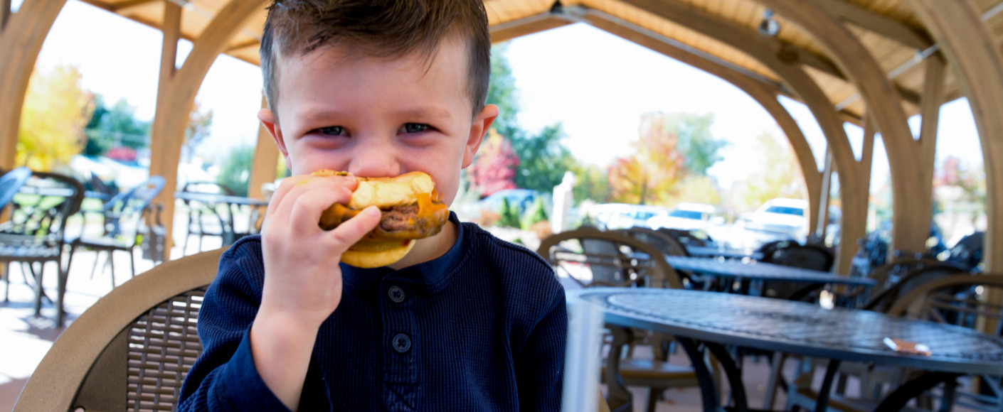 Is meat safe to eat - boy eating hamburger