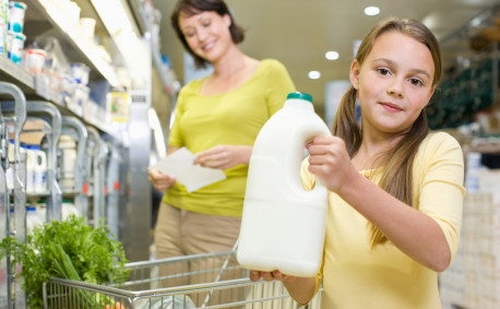 mom and daughter buying milk