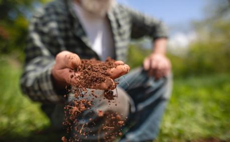 Farmer handling soil