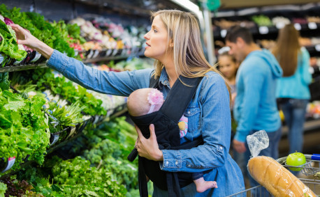 mom and baby buying vegetables